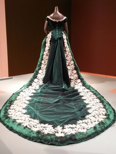 This green silk dress was made by an English designer named Charles Fredrick Worth in about 1888 for Princess Maria Maximilianova Romanovska (1841-1914), granddaughter of Tsar Nicholas I and great-granddaughter of Empress Josephine (from her marriage prior to Napoleon). The dress is made in green silk velvet with real silver trim and is really grand with this 12-foot train.