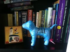 I got this dog doll from the workplace. cute :) #pink #dog #doll #shelf #books