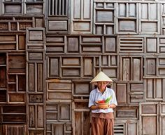 Public areas at the Six Senses Con Dao showcase walls constructed from antique Vietnamese doors.