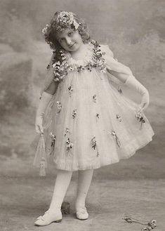 Edwardian girl in pretty dress postcard