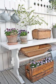VIBEKE DESIGN liking the different pieces used, the pots, crates and flowers