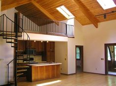 Contemporary kitchen with spiral staircase to loft! Homes for sale in Eaton, New Hampshire