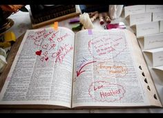 "An Interactive ""Guest Book""  Guests were instructed to choose a word that described the bride and groom in a dictionary, and sign their signature next to it. Their wedding planner, Heather Lowenthal from Posh Parties, provided markers and stamps, which made for an engaging experience."