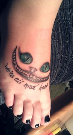Alice in Wonderland tattoo <3<3     From the original Alice in Wonderland with the new cheshire cat.  Alice:But I don't want to go among mad people.The Cat:Oh, you can't help that. We're all mad here. I'm mad. You're mad.Alice:How do you know I'm mad?The Cat:You must be. Or you wouldn't have come here.