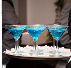 The Knottie Martini      What You Need      1 oz. Bacardi Superior Rum  1/2 oz. blue curacao  2 oz. pineapple juice  pineapple slice, for garnish        How to Make It    In a shaker, blend the pineapple juice, blue curacao, and rum. Strain into a chilled martini glass, garnish with a pineapple slice and serve immediately.