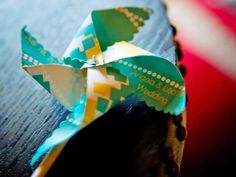 Party favors: For an outdoor wedding, how about a lighthearted pinwheel to catch the breeze? Make pinwheels to match the wedding's color palette, and include the name of the couple and the date of the wedding. Blank paper pinwheels can be purchased from Paper Source, along with ribbon, paint, stamps and more.