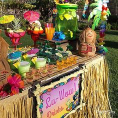 Create a tiki bar with an authentic tropical flair! Click through for colorful margarita glasses, tumblers, Natural Raffia Table skirt and more!