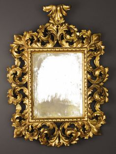 An Italian Baroque-style Carved and Giltwood Mirror. Unknown maker,Venice, Italy. Nineteenth century.