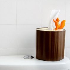 Adorable tree stump  and squirrel Tissue dispenser by Qualy Design