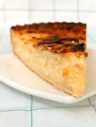 Tarte au riz is a pie with a rice pudding filling. It originates and is popular in the Eastern part of Belgium.