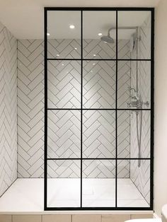 I'm in love with the herringbone tile and the amazing crittall shower screen from Creative Glass Studio in London Modern Bathroom Tile, Mosaic Bathroom, Bathroom Interior Design, Mosaic Tiles, Master Bathroom, Attic Bathroom, Bathroom Showers, Bathroom Glass Wall, Bathroom Lighting