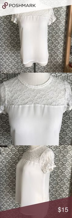Nwot sheer lace short sleeve blouse Absolutely stunning airy lightweight sheer gorgeous lace accent at the top with a beautiful small opening with a button in the back Tops Blouses