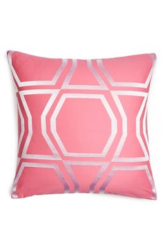 Pink geometric tiles by Kate Spade will add cosmopolitan charm to the room.