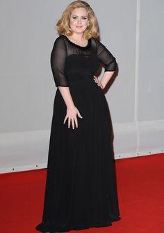 Vestido de fiesta negro largo de Burberry con escote y mangas transparentes.
