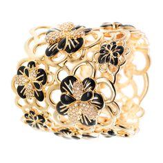 CIRO Jewelry Traviata gold arm cuff. Interlacing floral design cuff. White CIROLIT stones. Black enamel. Secure clip closing. Gold plated.