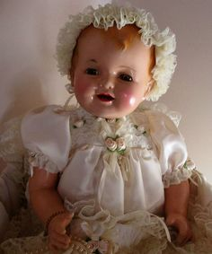 Gorgeous 1940 original Effanbee Lovums composition doll with fat chubby baby legs.  Adorable...traveled all the way from Tasmania, AU to live with me in Texas!  She's a Southern Belle now with a bit of a down under accent! :-)