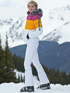 Josephina in horizontal large stripes of white, mango, & fuchsia on her faux fur lined hood ski jacket.