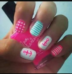 Pink and white polka dotted nails with blue stripes and anchors