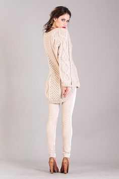 First Born's intricate cable knit sweater is a versatile knit that will never go out of style.. Shorter in the front and longer at the back, the assymetic style