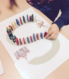 Fun fine motor activity - placing blocks or dominoes along a preprinted path