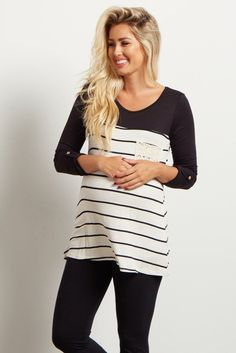 Have a blast in this colorblock black and striped top! Wear it on a casual day with maternity jeans an wedges. The crochet pocket accent gives it the extra flare of daintiness to help you achieve a chic, feminine look.