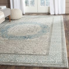 Indulge in this majestic 10' x 14' rug from Safavieh's stately yet chic Sofia Collection. Drawing inspiration from old world styling and classic oriental motifs, this light grey and blue rug features