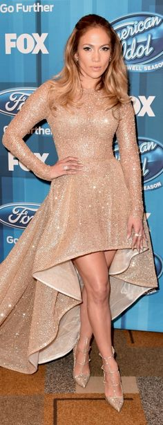 Who made Jennifer Lopez's glitter pumps, jewelry, and gown?