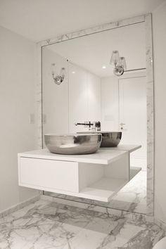 Huge floor-length mirror in bathroom with a floating vanity, marble floors, and stainless steel sink. Lovely!