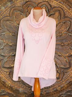 """Pink Cowl Neck Long-sleeve Tunic Pink by Karen Faye and Company. Look fabulous in our very feminine """"Bella"""" Pink long-sleeved tunic. The sleeves are embroidered in our """"Bella"""" design with back side of this tunic has a unique embroidered motif in the back above the Godet. Layer it with leggings or skinny jeans, incredibly soft and comfortable!"""