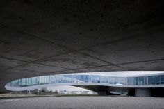 How curved concrete and glass aesthetically work together. Rolex Learning Center by SANAA
