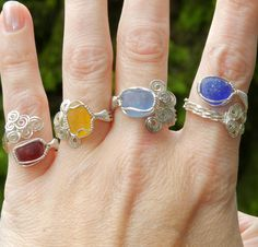 Wire wrapped multi-color sea glass rings found at, www.artisanseaglass.com. Each…