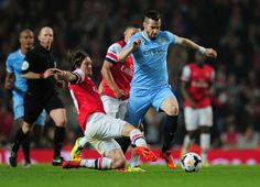 Alvaro Negredo Photos Photos - Alvaro Negredo of Manchester City is closed down by Tomas Rosicky and Alex Oxlade-Chamberlain of Arsenal during the Barclays Premier League match between Arsenal and Manchester City at Emirates Stadium on March 29, 2014 in London, England. - Arsenal v Manchester City - Premier League