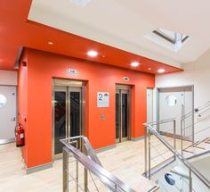 Office Design - Hallway - Stairwell - Signage - Orange - Accent Wall - Levels - Office Fit Out - The Chancery Building, Dublin by Think Contemporary