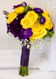 Local Wedding Expert Tina Riddell at Living Fresh in Kitchener, ON made this amazing purple and yellow bouquet!