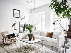 This Living Room is beautiful! We love the minimal white and those bright pops of green! - JT Rose & Co