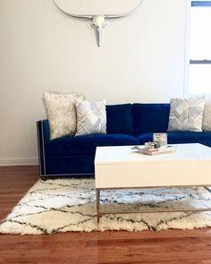 A minimalist, modern living room set up with sleek design elements.
