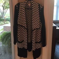 Chico's long cardigan EUC wore once. Zigzag pattern, shawl collar, two small front pockets and ribbed sleeves. 60% cotton & 40% acrylic hand wash. Chico's size 2 is equivalent to a size M/12 Chico's Sweaters Cardigans