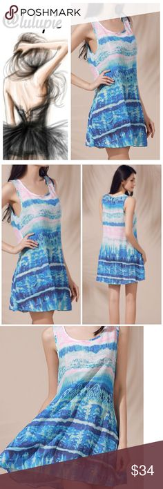 """✳️ SALE✳️ Blue Watercolor Sundress Blue and pastel pink water color sleeveless sundress. Round color and A line cut. The dress is not lined. Made of cotton blends and polyester.   Measurements  Small Bust 37"""" / length 32.6""""  Medium bust 39""""/ length 33""""  Large bust 40""""/ length 33.5""""  Reasonable offers considered through offer button only   NO TRADES Bchic Dresses"""