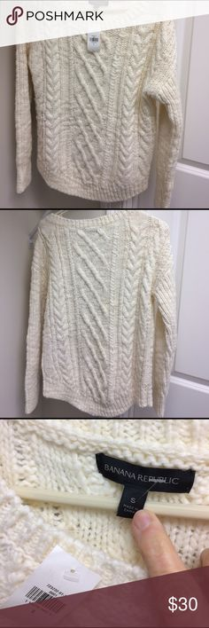 """NWT Banana Republic Canle knit sweater Gorgeous Banana Republic cream cable knit sweater. Rounded bottom 24 1/2"""" long in front 26 1/2"""" in back. Chest 20"""". 50% wool 50% acrylic. Super soft and thick. Banana Republic Sweaters Crew & Scoop Necks"""