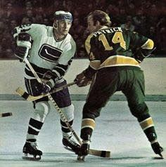 Dave Balon of the Canucks against Craig Patrick of the Seals.