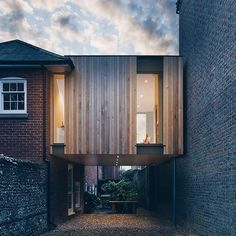 British architect Adam Knibb has extended a house in a converted school in Winchester England by building a timber box above a seldom-used driveway via @dezeen