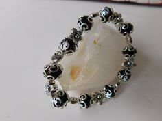 Hey, I found this really awesome Etsy listing at https://www.etsy.com/listing/480449695/black-silver-colored-bracelet-handmade
