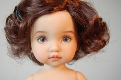 Very hard to make out the difference. Its a Doll