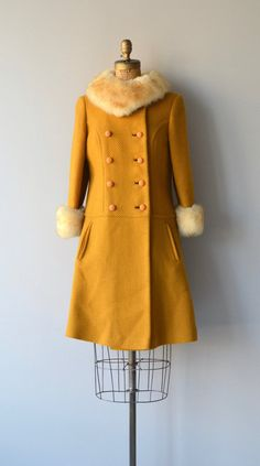 Vintage 1960s bright mustard yellow wool coat with faux fur collar and cuffs, double breasted dome buttons, princess seams, hip pockets and gold satin