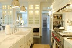 kitchens - Sloane Street Shop Lights with Metal Shades, metal island pendants, metal kitchen pendants, farmhouse sink, white cabinets, white kitchen cabinets, white marble countertops, stove alcove, range alcove, alcove stove, alcove range, cooktop spice rack, built in spice rack, built in microwave nook, glass front kitchen cabinets,