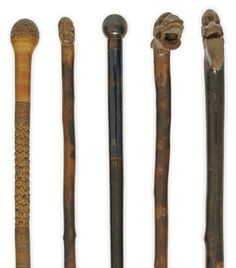 Oriental carved walking sticks found on Christies. Com