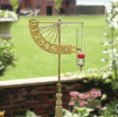 "This conversation piece is inspired by some of the inventions of founding father Thomas Jefferson, who had a noted affinity for invention.  The high-quality brass, glass, and stainless steel construction captures the spirit of early America.  This device is not only a way to measure precipitation in your garden or yard, but also a serious statement maker.  This rain gauge displays up to 5"" ofrain in "" increments.  Comes with a pressure treated wooden stake for easy installation in the ground…"