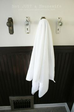 Use door knobs instead of towel bars is a great way to make bathroom beautiful.