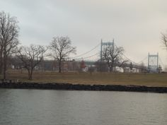 """I admire the life of Robert F. Kennedy.  But, """"Triboro"""" is the perfect name for a bridge connecting Queens, Manhattan, and the Bronx.  This photo of the bridge (and Randall's Island Park) was taken from the Circle Line Ferry."""