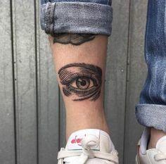 Linework eye tattoo by Bombayfoor